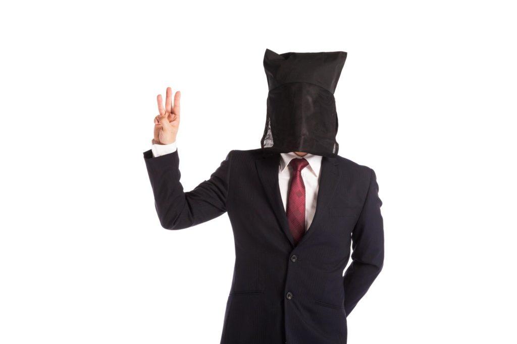 3本指を立てる黒子の画像